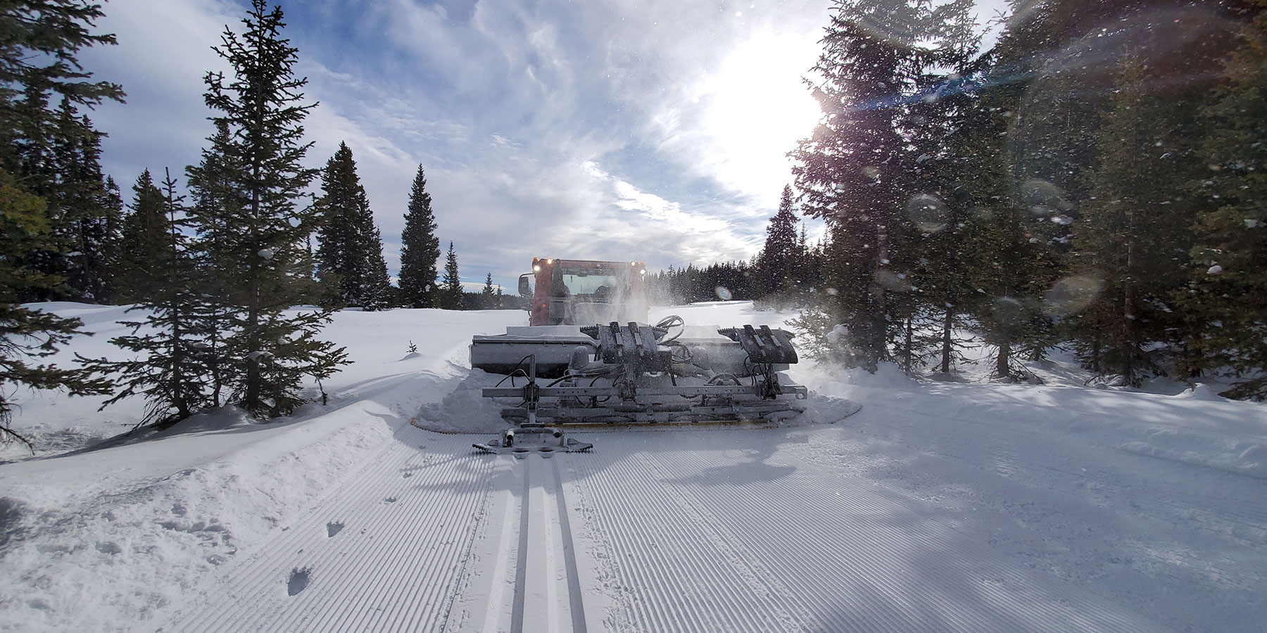 Grooming of cross country ski trails of Grand Mesa Nordic Council with PistenBully 400.