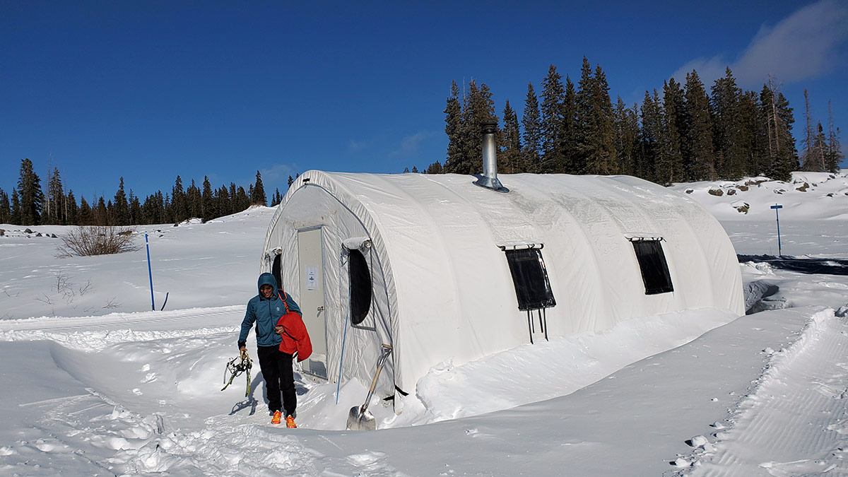 A skier leaving the warming hut at Skyway trail system on Grand Mesa.