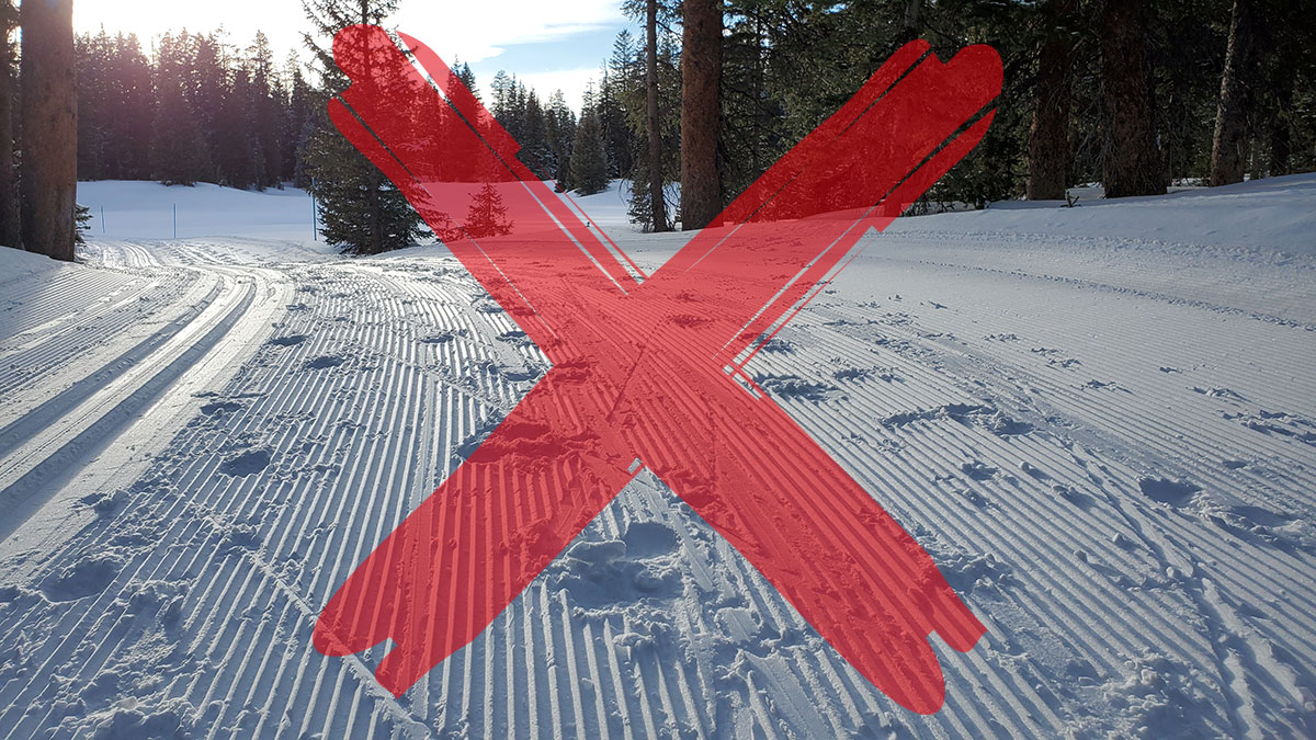 Don't destroy groomed ski skate track by walking on it.